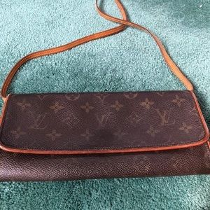 Louis Vuitton crossbody or clutch